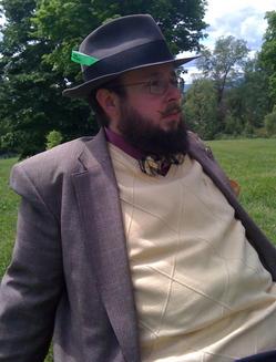 Erik reclines in a park.